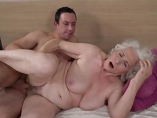 Grey-haired female gets her flimsy cunt fucked by younger boy