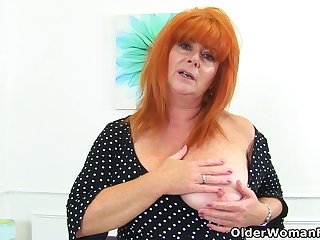 English milf Ginger Tiger fingers will not hear of wet fanny
