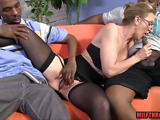 Hot skinny MILF in glasses interracial gangbang