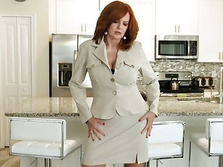 Red haired cougar Andi James is playing at hand her old jugs and stretched twat